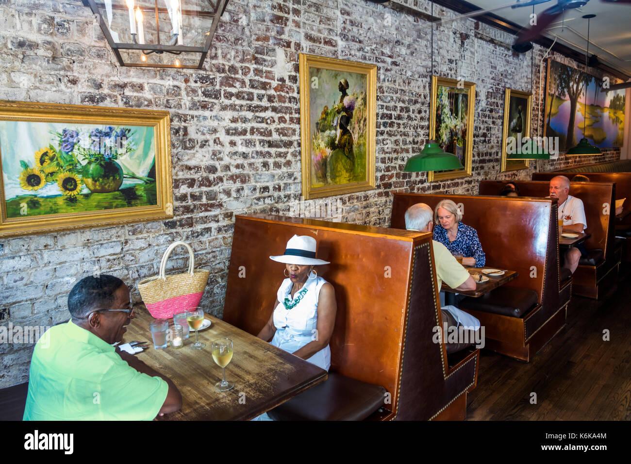 Charleston South Carolina SC Historic Downtown Virginia's On King restaurant southern cuisine dining Black man - Stock Image