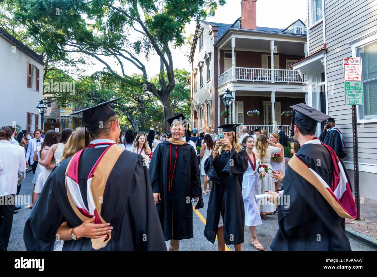 Charleston South Carolina SC College of Charleston university graduation ceremony commencement student crowd posing - Stock Image