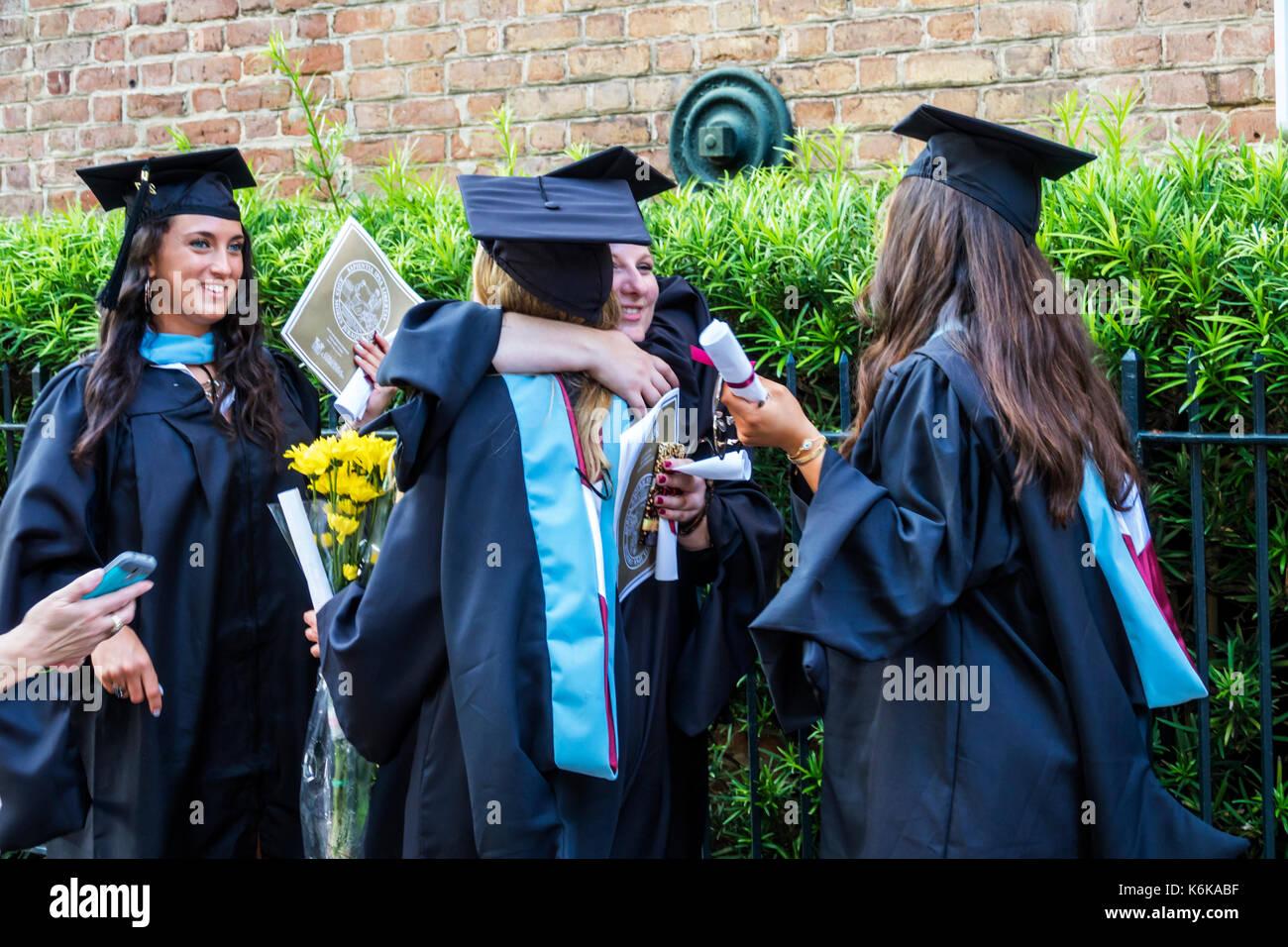 Charleston South Carolina SC College of Charleston university graduation ceremony commencement student hugging celebrating - Stock Image