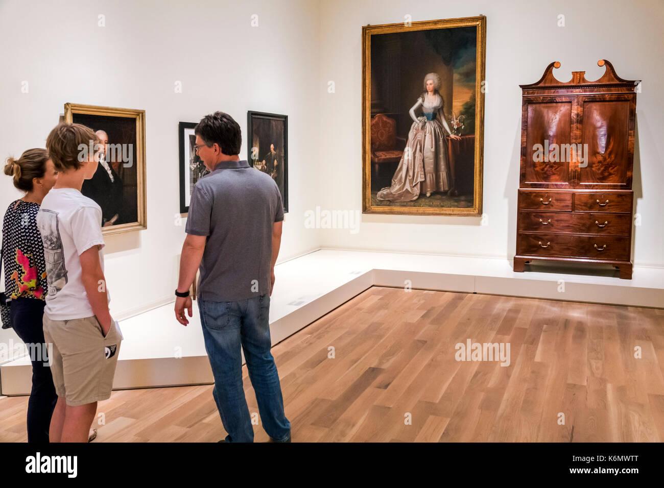 Charleston South Carolina SC Historic Downtown Gibbes Museum of Art exhibit interior gallery family teen boy - Stock Image