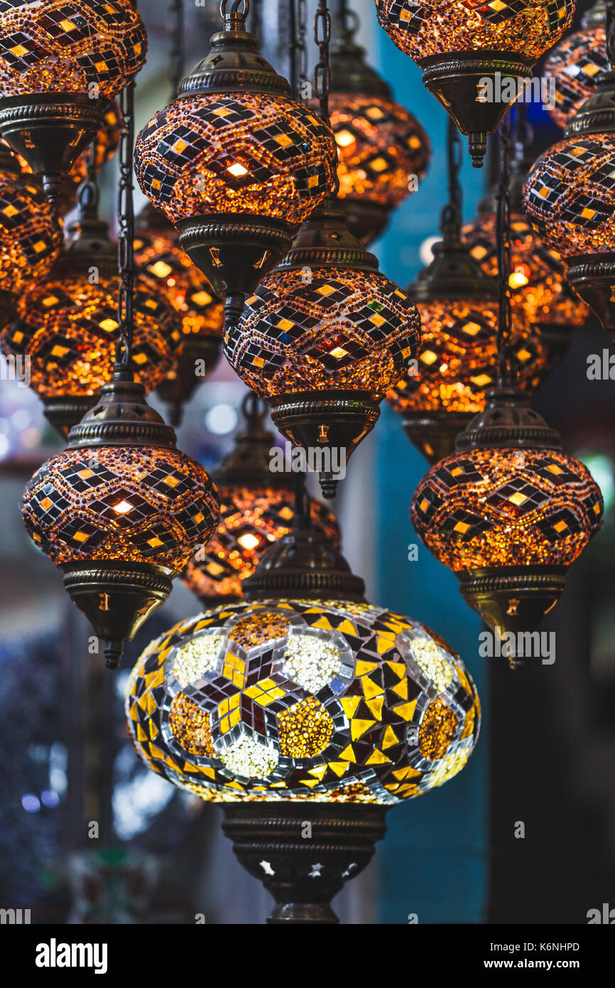 Amazing traditional handmade turkish lamps in souvenir shop. Mosaic of colored glass. Lit in the evening, creating - Stock Image