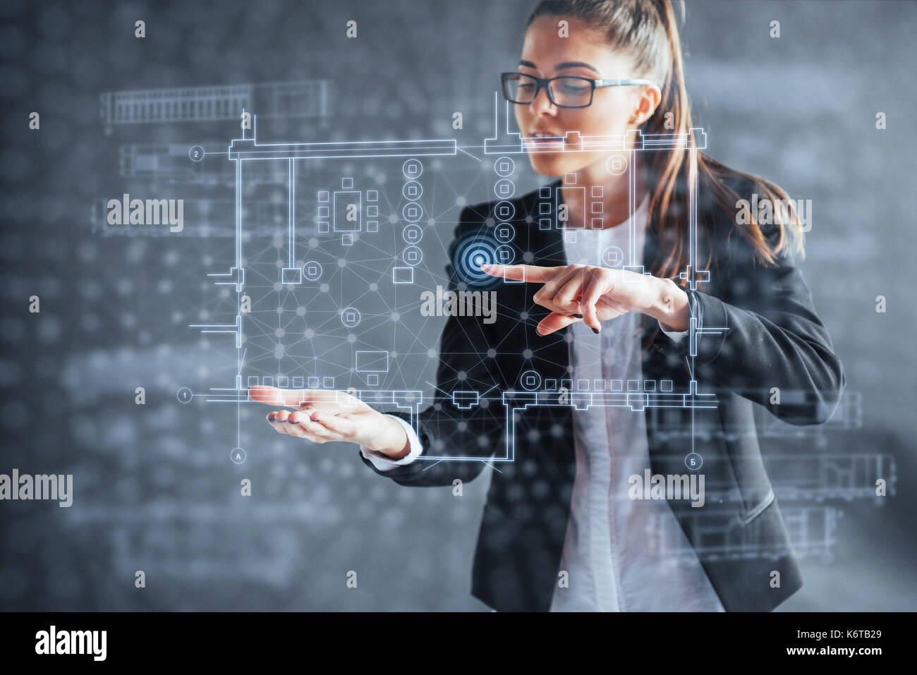 The person at the board of a financial dashboard of key indicators of stock market performance and business intelligence. - Stock Image