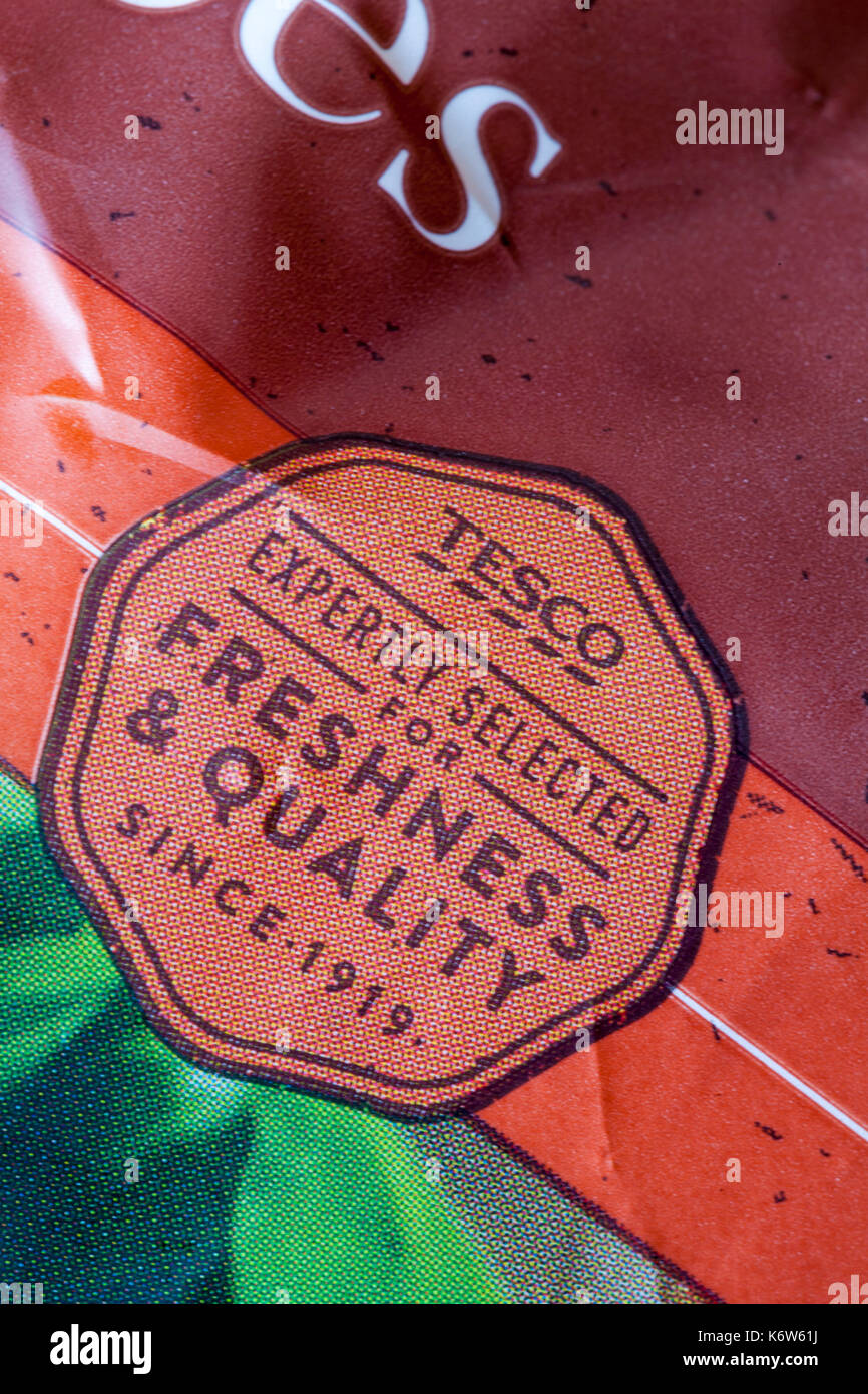 Tesco expertly selected for freshness & quality since 1919 symbol on packet of potatoes - Stock Image