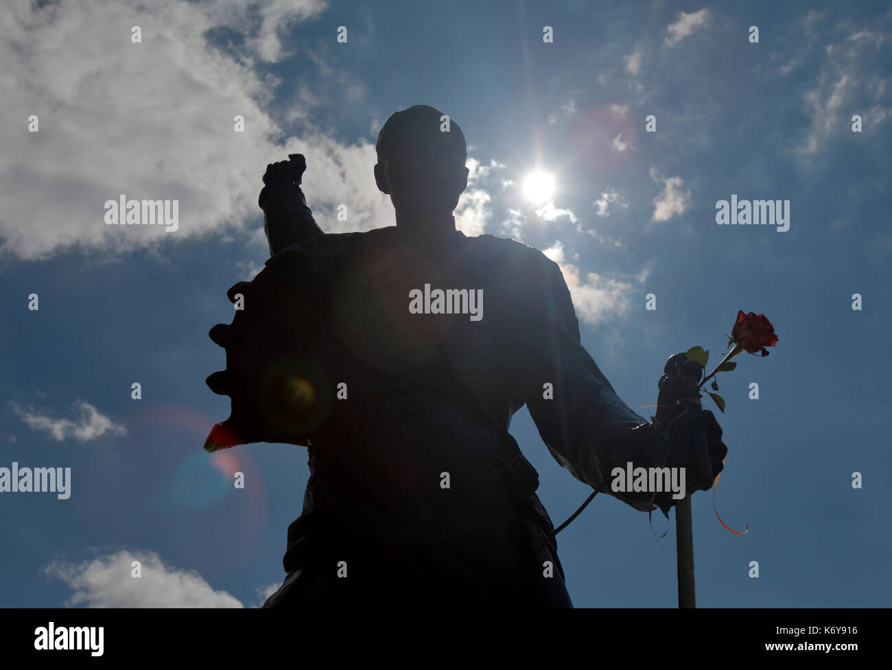 Silhouette of the statue of Freddie Mercury is on the waters edge of Lake Geneva in Montreux Switzerland at the - Stock Image