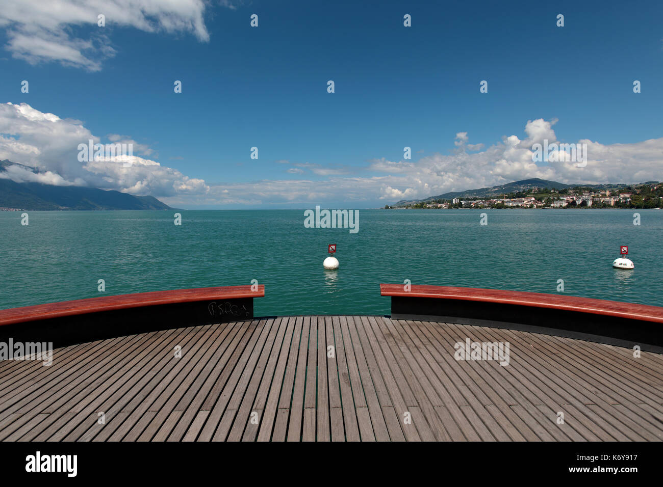 The Platform Sur Mer looks out over Lake Geneva in Montreux Switzerland in the Alps. It is right next to the statue - Stock Image