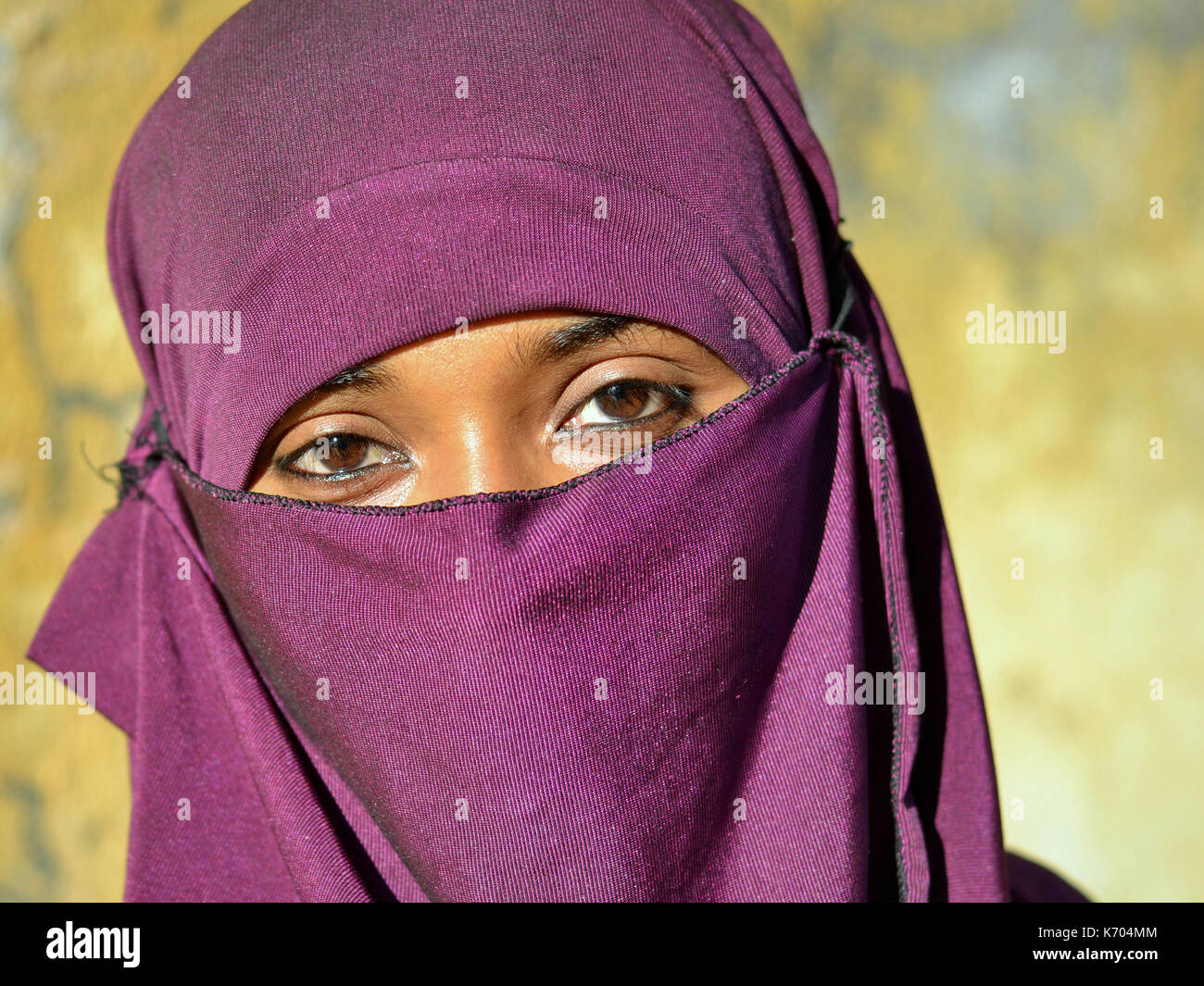 Young Indian Muslimah with violet niqab; Junagadh, Gujarat, Western India - Stock Image