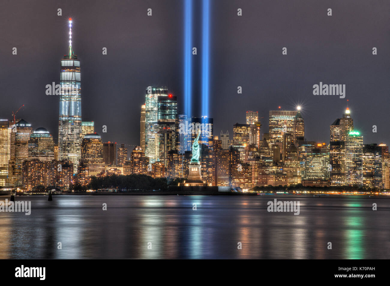 9/11 Memorial Beacons & Statue of Liberty - Stock Image