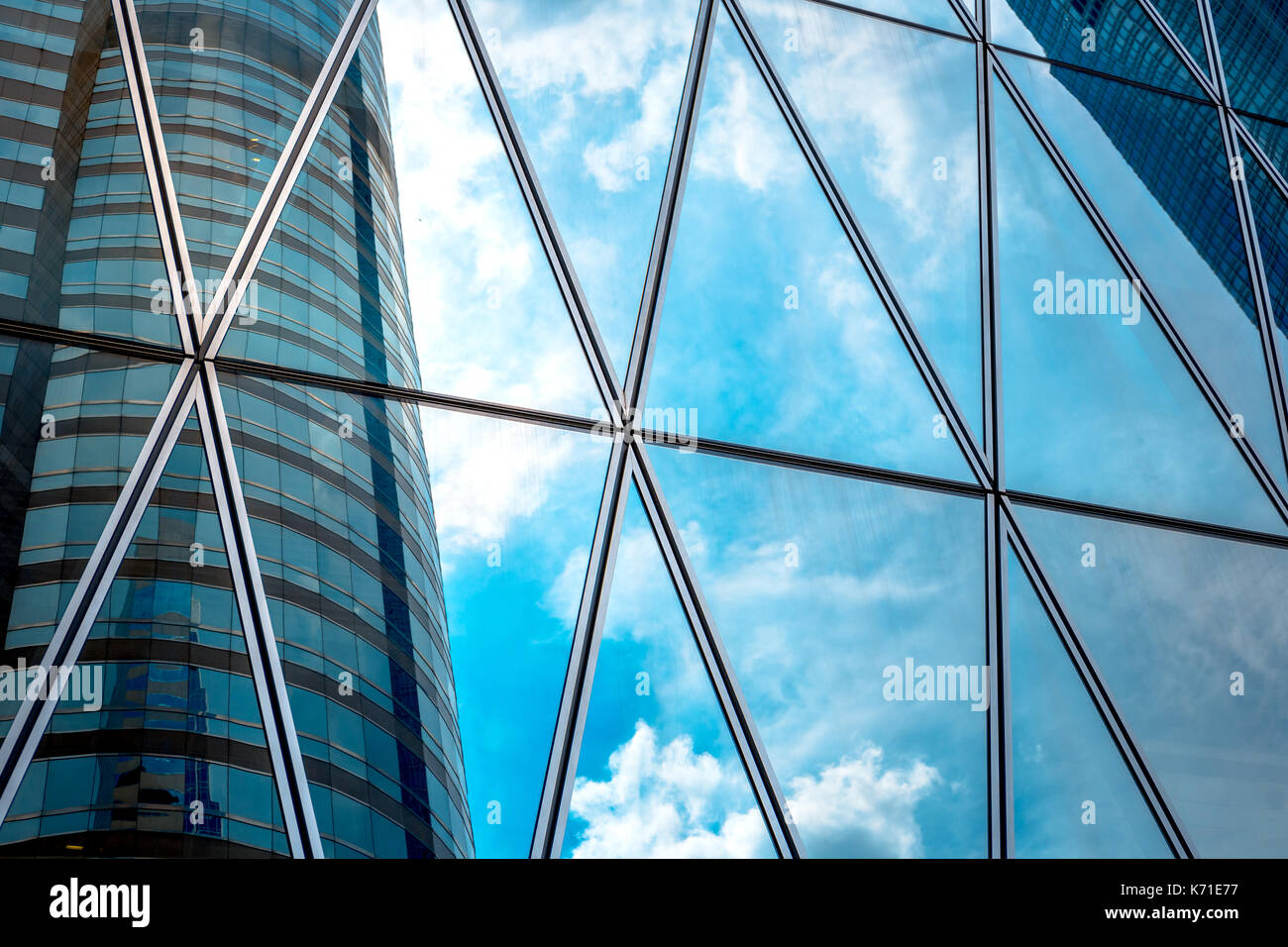 Modern office building detail, glass surface - Stock Image