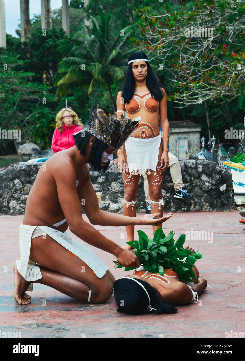 A Taino man and woman natives of Cuba perform a traditional healing ritiual for tourists Stock Photo