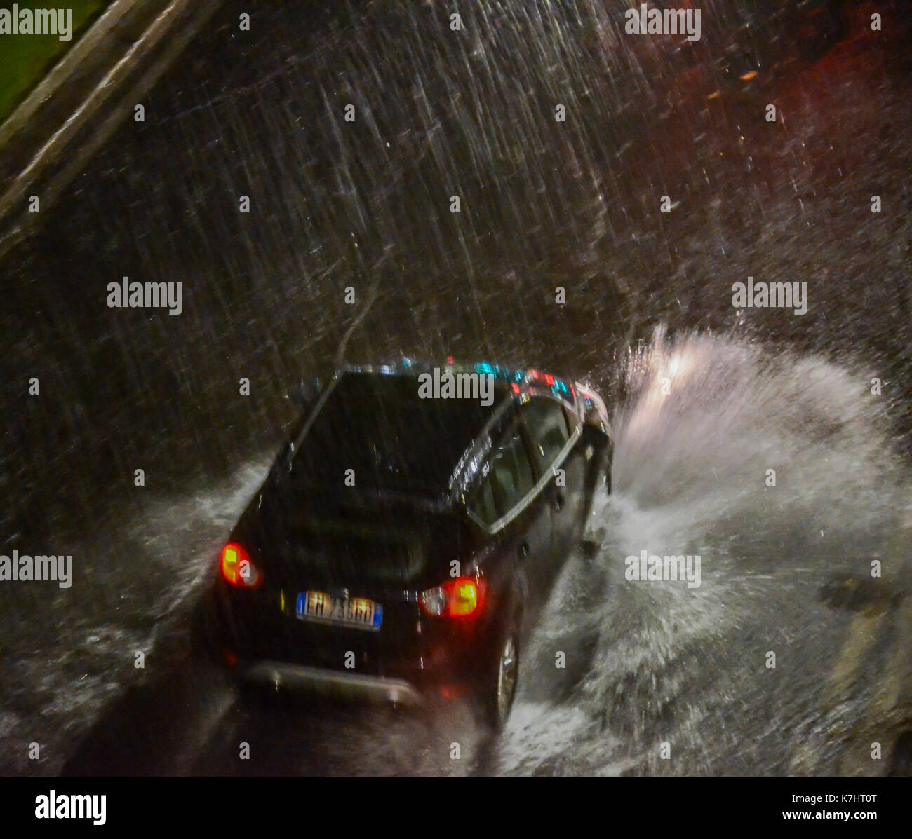 Torrential rain in a street in Milan, Italy Stock Photo