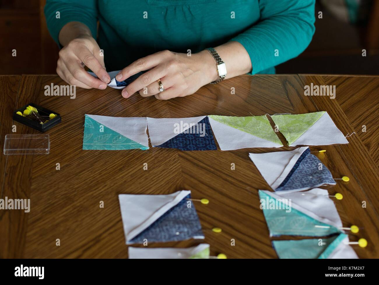 Close up of a person creating a quilt block. - Stock Image