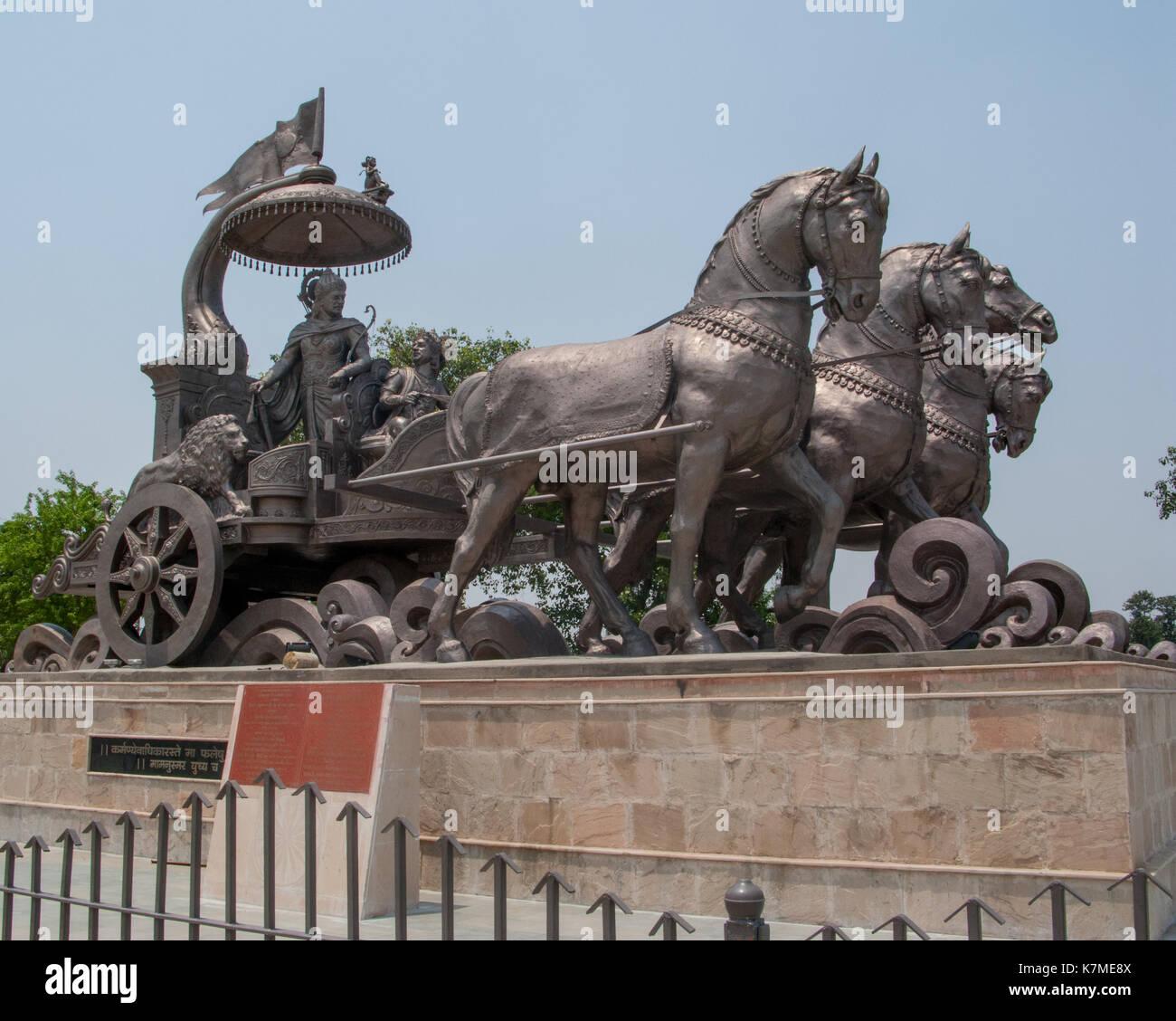 The statue of Krishna and Arjuna on the chariot, without people.  Kurukshetra, Haryana, India. - Stock Image