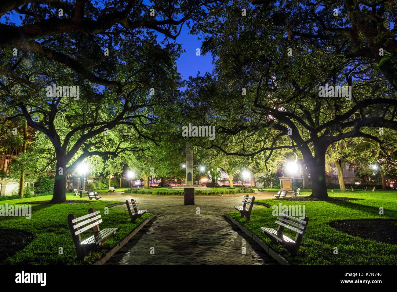 Charleston South Carolina SC Historic Downtown Washington Square urban park lighting bench dusk - Stock Image