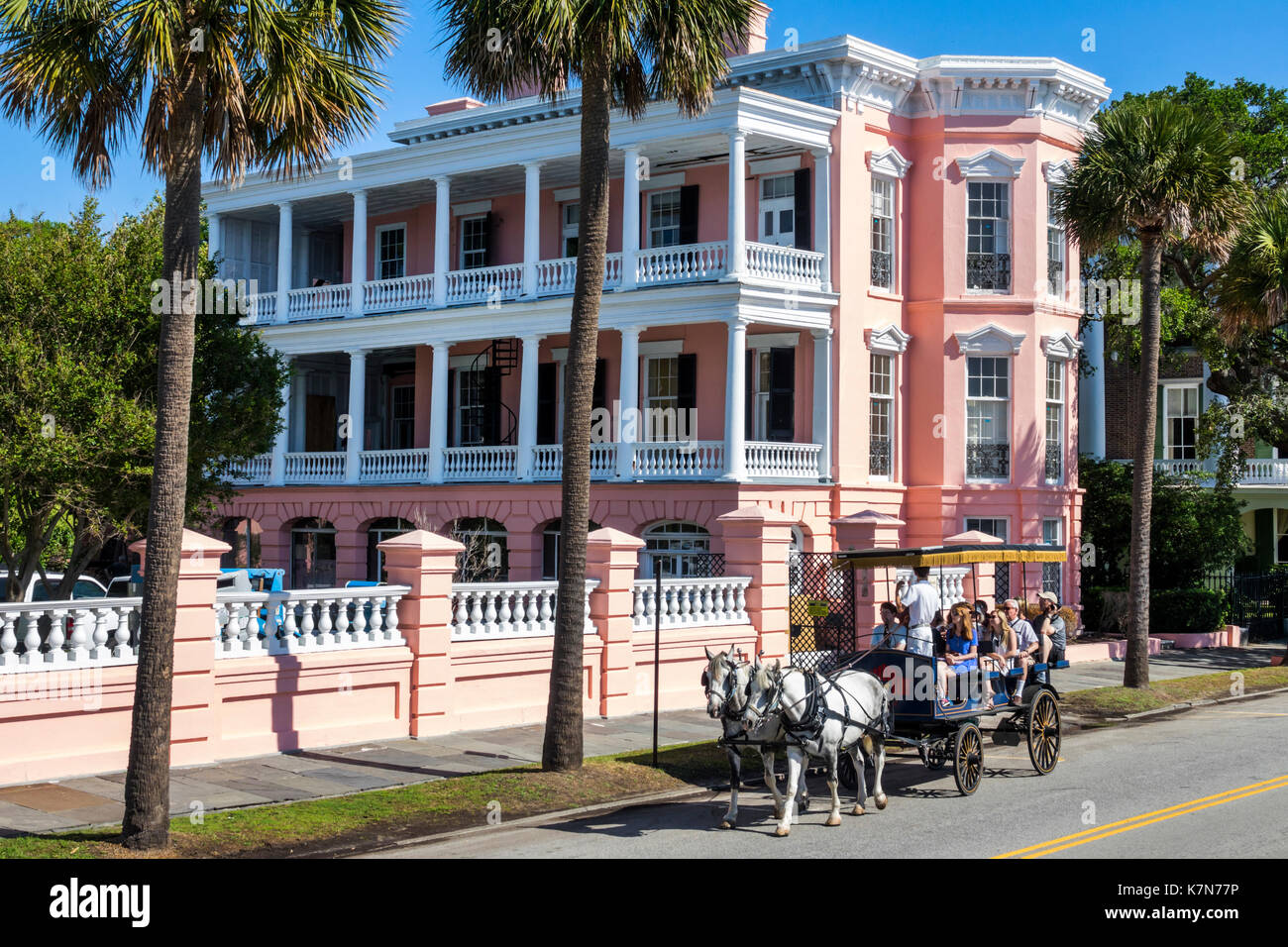 Charleston South Carolina SC waterfront East Battery Palmer House historic mansion Antebellum pink horse-drawn carriage - Stock Image