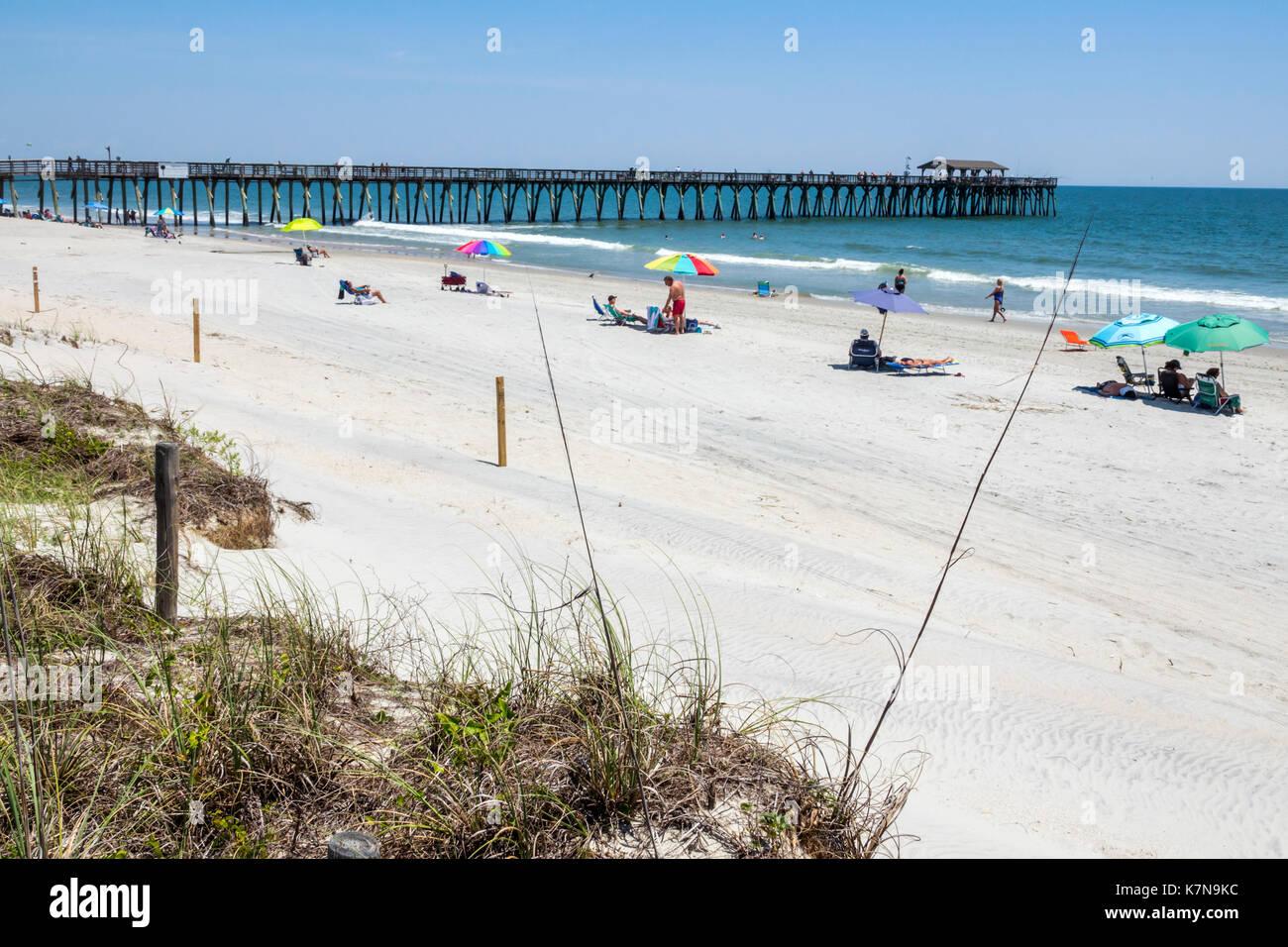 Myrtle Beach South Carolina SC Atlantic Ocean Myrtle Beach State Park sand fishing pier dune sunbathers - Stock Image