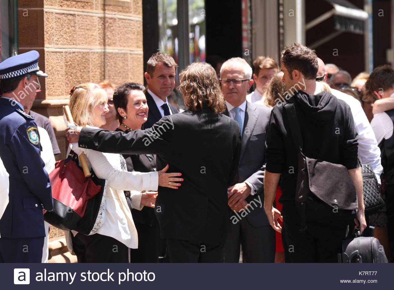 Lord Mayor Clover Moore, NSW Premier Mike Baird and Tori Johnson's father Ken Johnson. VIP dignitaries and family - Stock Image