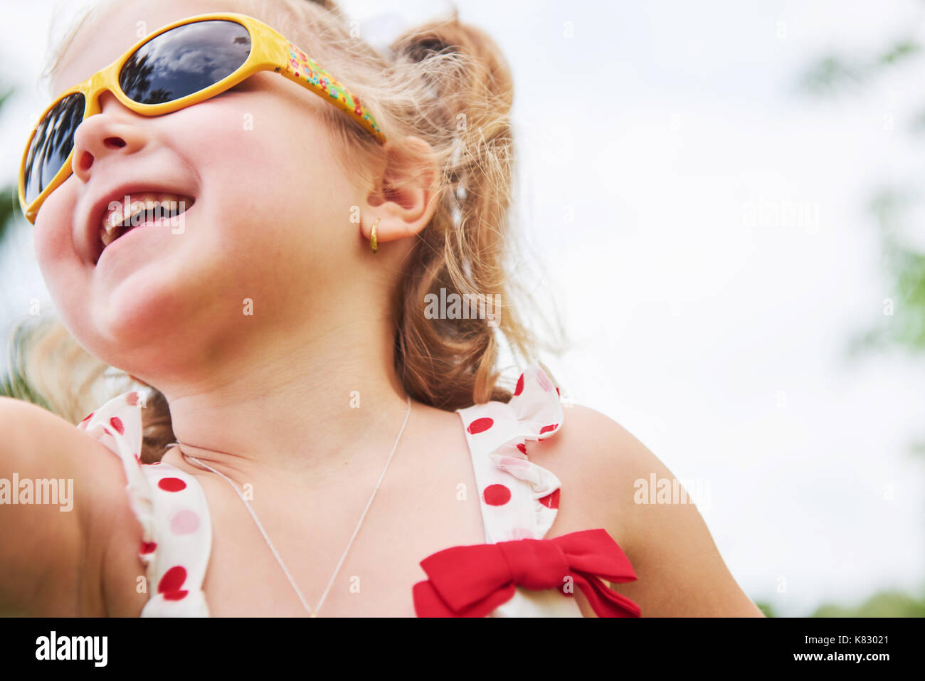 happy baby girl in a summer sunglasses - Stock Image
