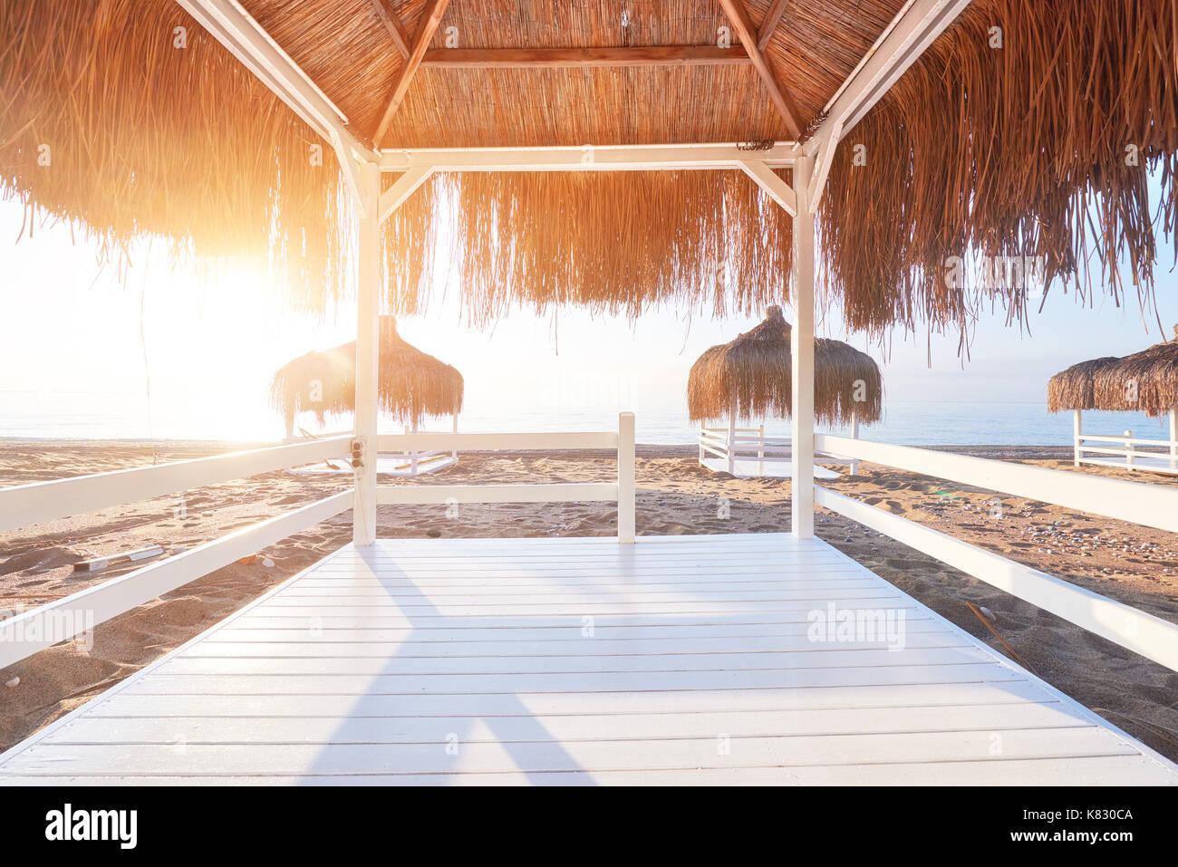 White chairs on the beach resort famous Amara Dolce Vita Luxury Hotel. Resort. Tekirova-Kemer. Turkey. - Stock Image