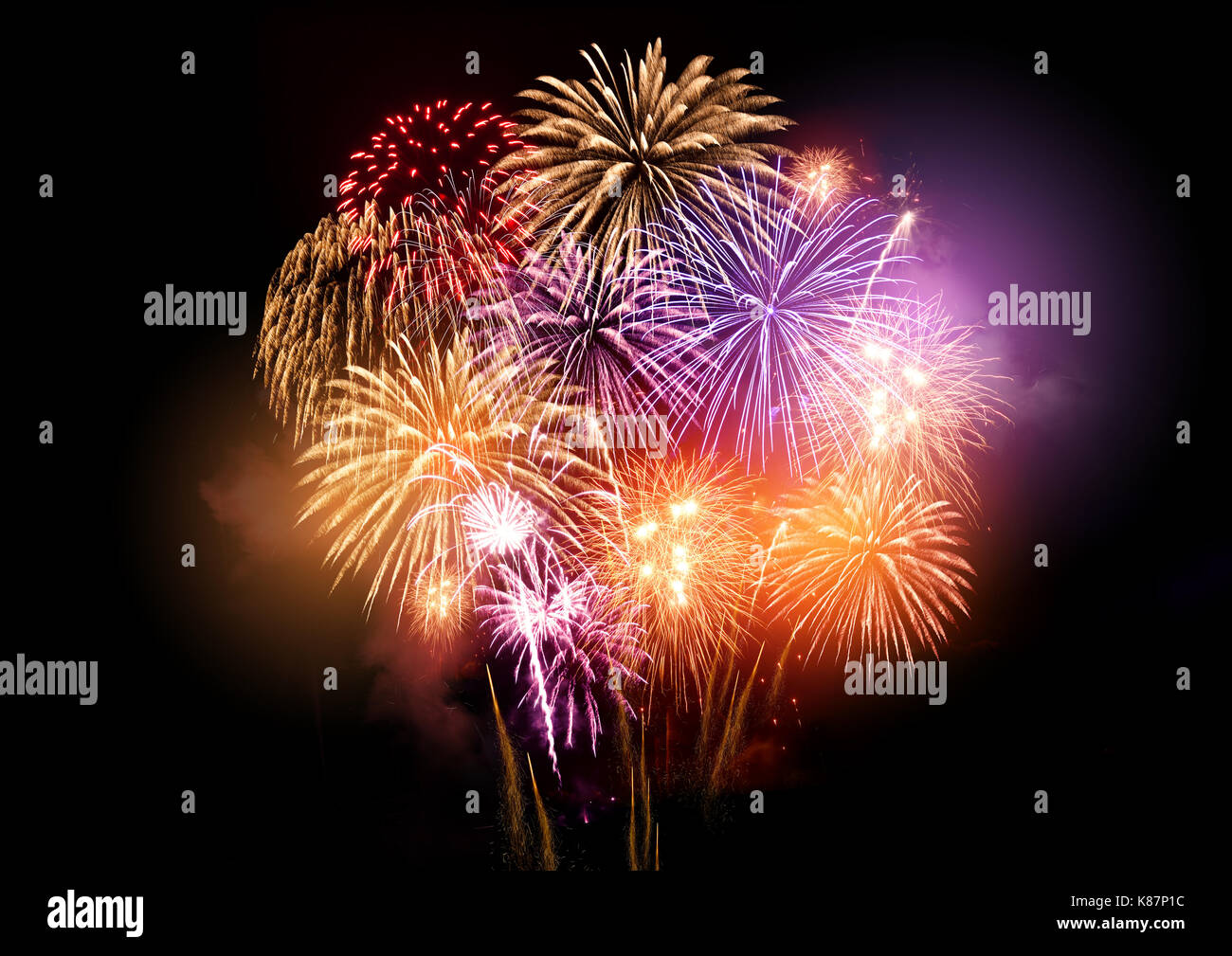 Bright and colourful fireworks display celebrations at night. - Stock Image