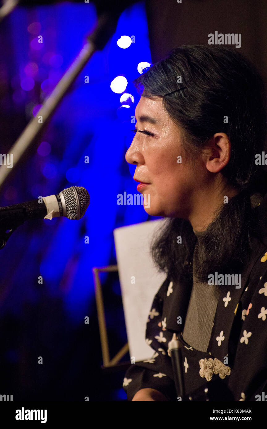 Kazuko Hohki aka Kazumi Taguchi of Frank Chickens playing a traditional Japanese stringed instrument and singing - Stock Image