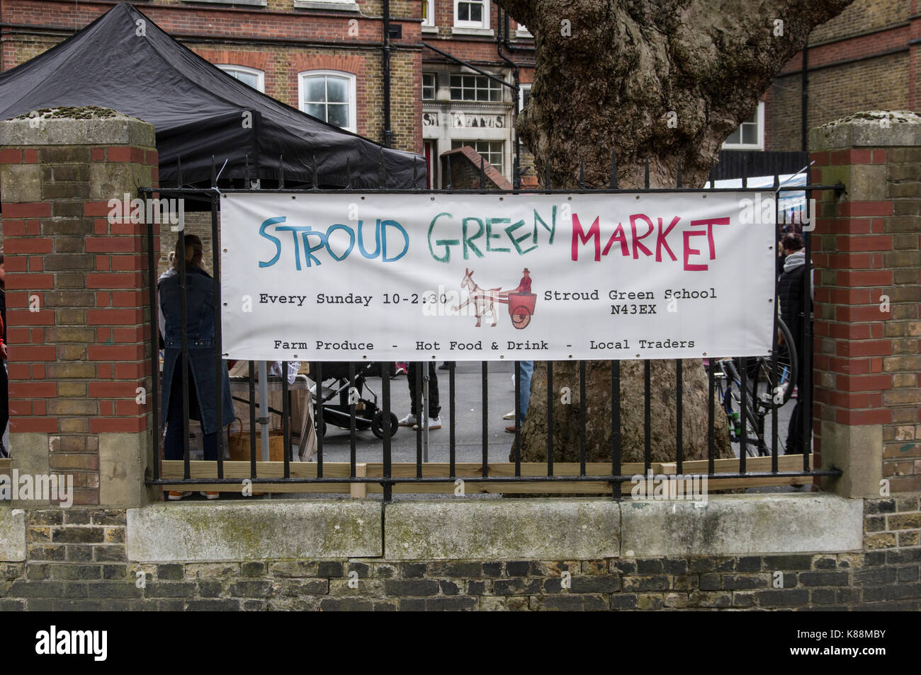 Stroud Green Market sign in London on Ennis Road near Finsbury Park Station selling mainly vegetarian and vegan - Stock Image