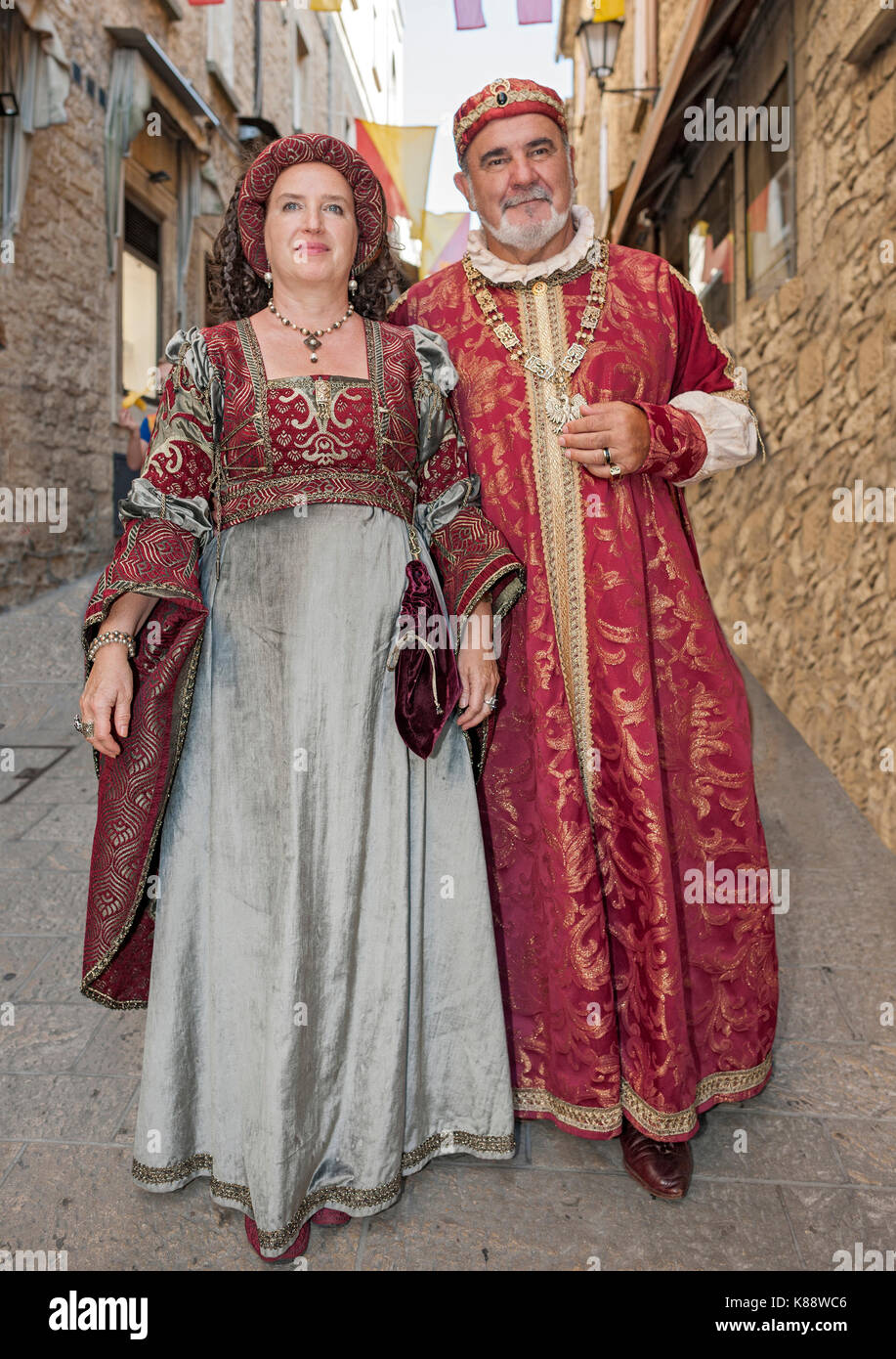 San Marini couple in period outfits for the annual Medieval Days Festival held in the old town of San Marino in - Stock Image