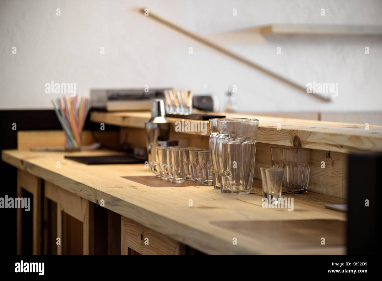 empty glasses on bar counter - Stock Image