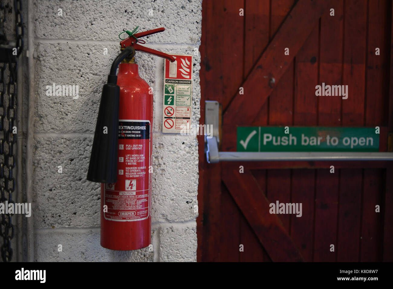 Wall Mounted  Carbon dioxide Fire extinguisher - Stock Image