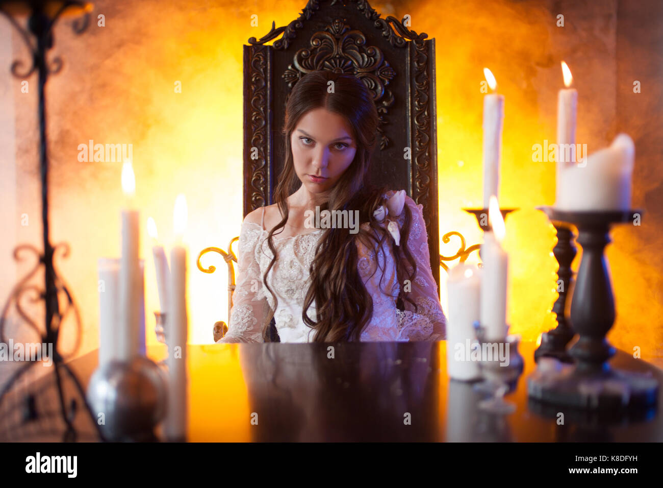 Gothic Style Fireplace Stock Photos amp Gothic Style  : beautiful young woman in vintage dress at a table in the mystic manor K8DFYH from www.alamy.com size 1300 x 956 jpeg 143kB