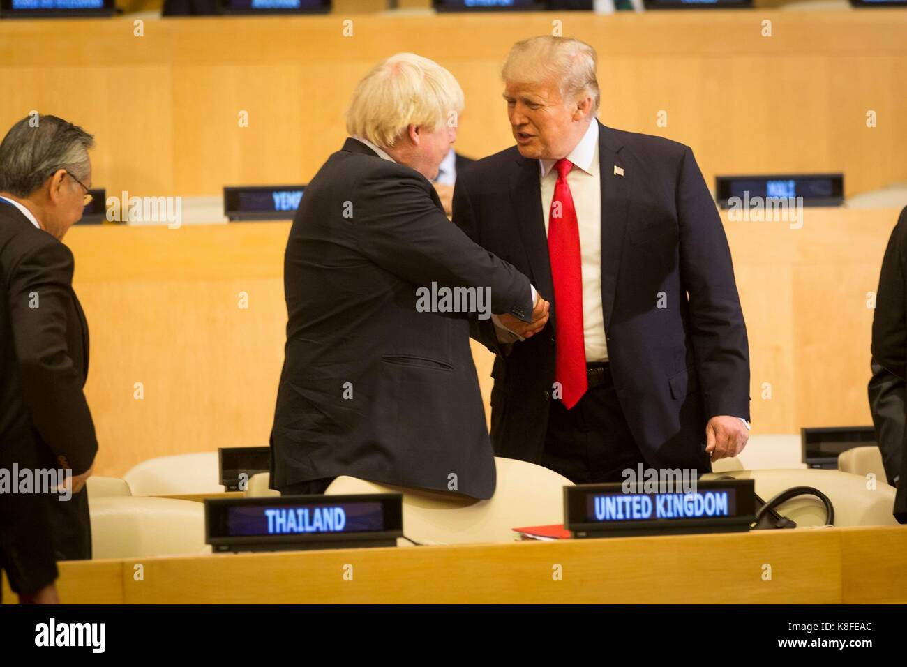 U.S. President Donald Trump, right, shakes hands with British Secretary of State for Foreign and Commonwealth Affairs - Stock Image