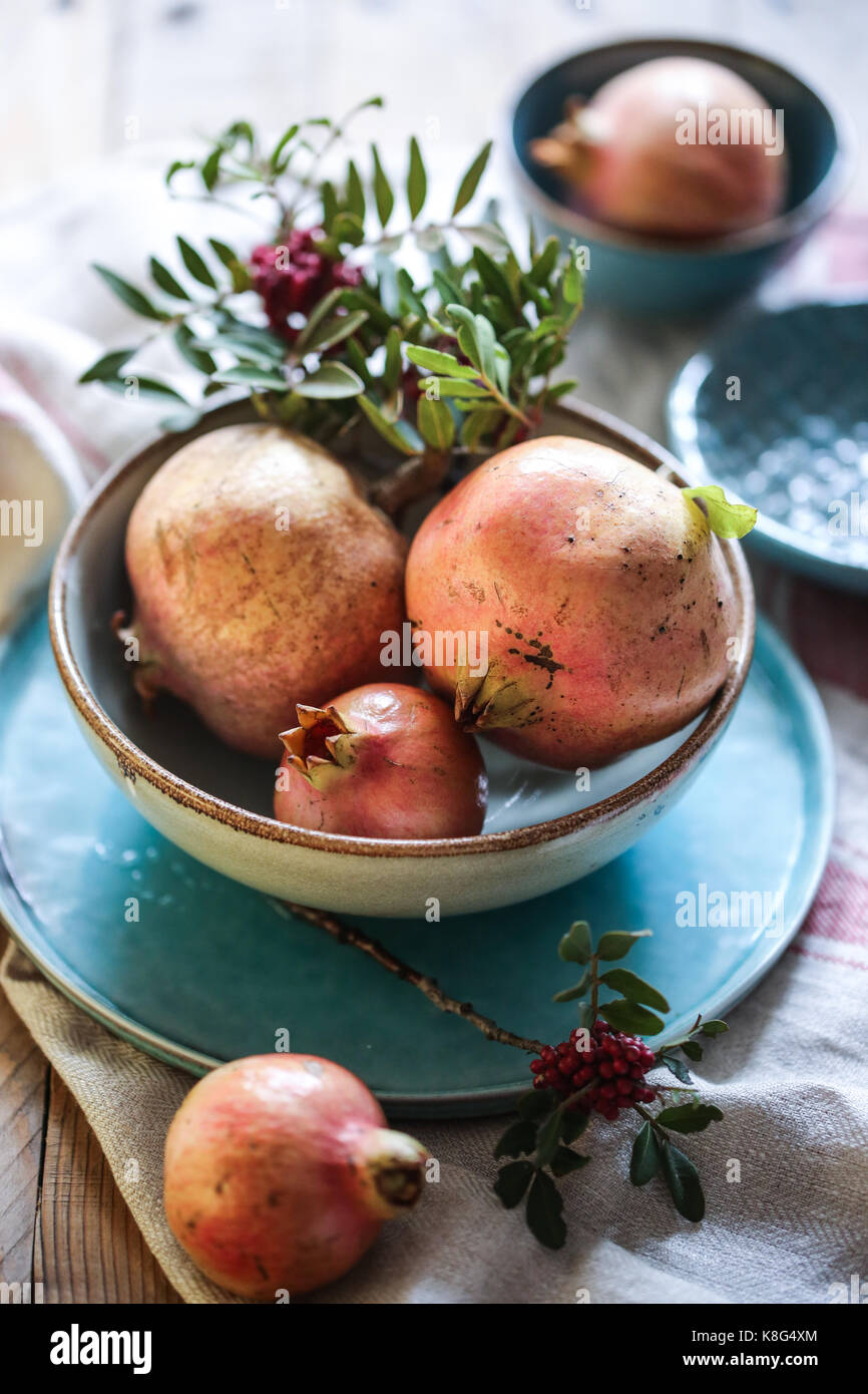 Pomegranates in a blue bowl - Stock Image