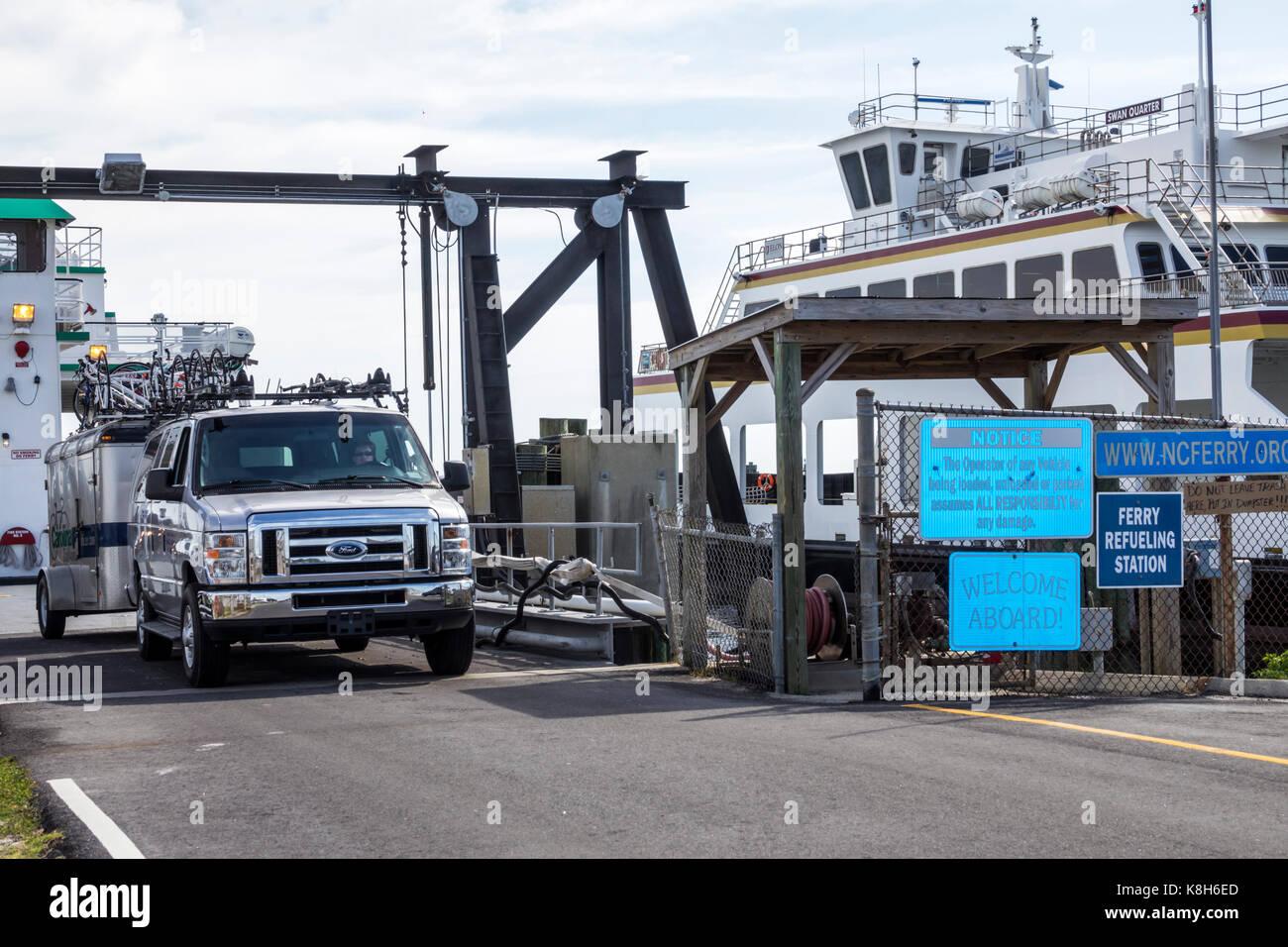 North Carolina NC Cedar Island Outer Banks Ferry Terminal slip boat unloading van - Stock Image