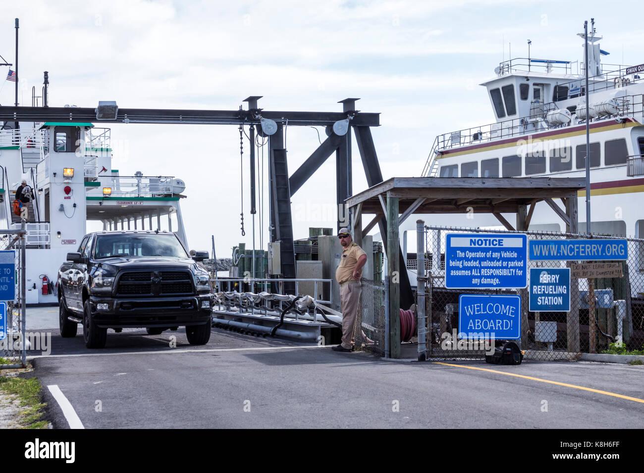 North Carolina NC Cedar Island Outer Banks Ferry Terminal slip boat unloading truck - Stock Image