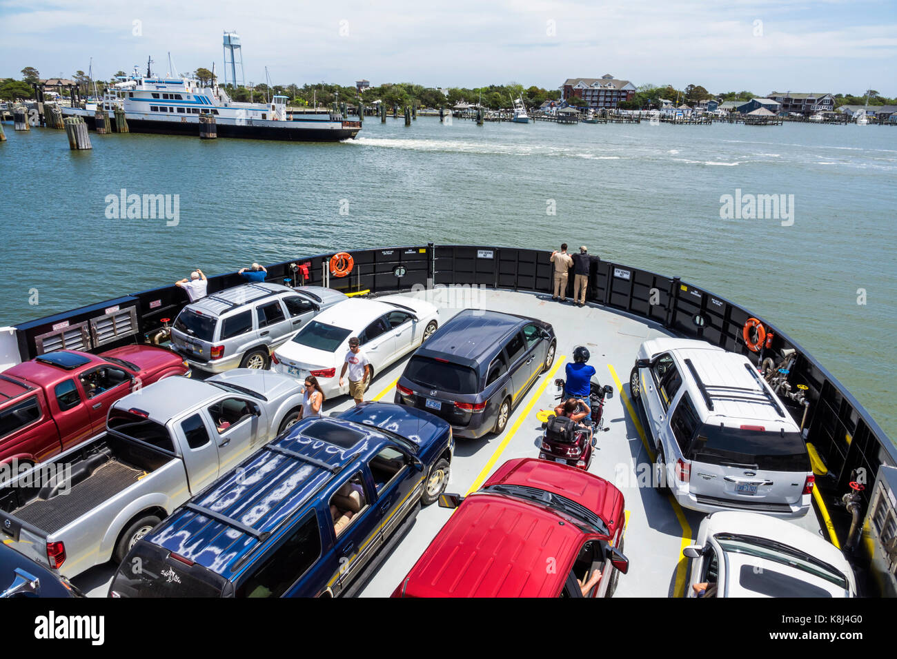 Outer Banks North Carolina NC Ocracoke Island ferry boat harbor arriving cars vehicles - Stock Image