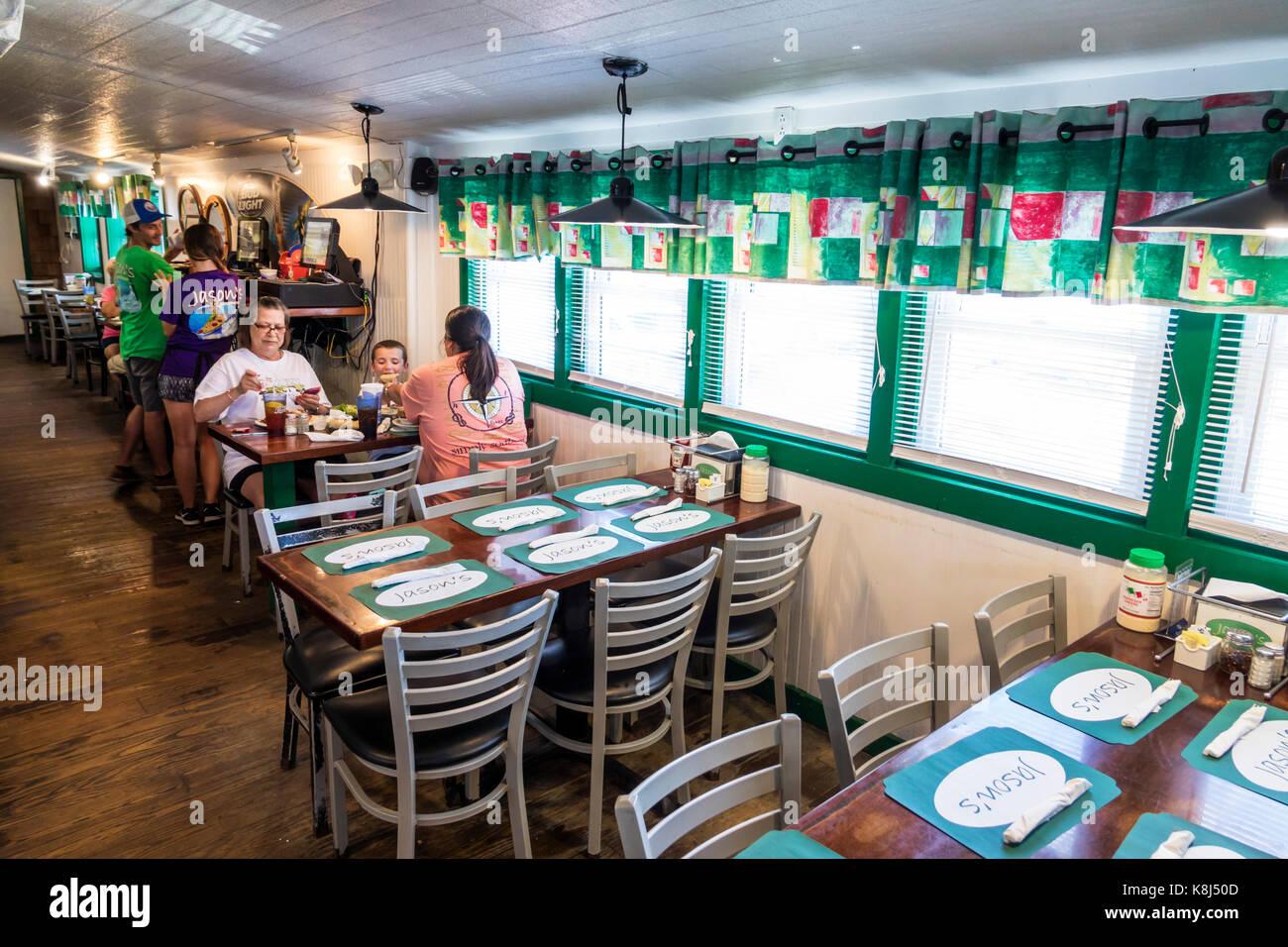 Outer Banks North Carolina NC Ocracoke Island Jason's Restaurant seafood table family dining - Stock Image