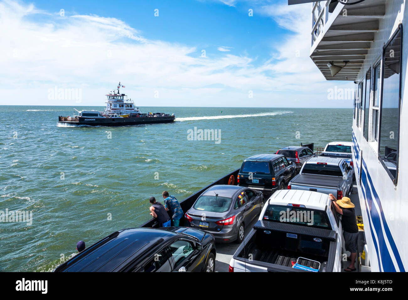 Outer Banks North Carolina NC Pamlico Sound Ocracoke Island Hatteras ferry boat water cars vehicles waves - Stock Image