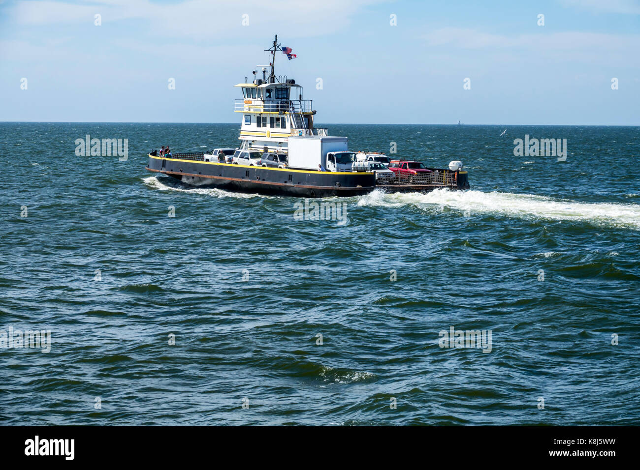 Outer Banks North Carolina NC Pamlico Sound Ocracoke Island Hatteras ferry water navigating vehicles waves - Stock Image