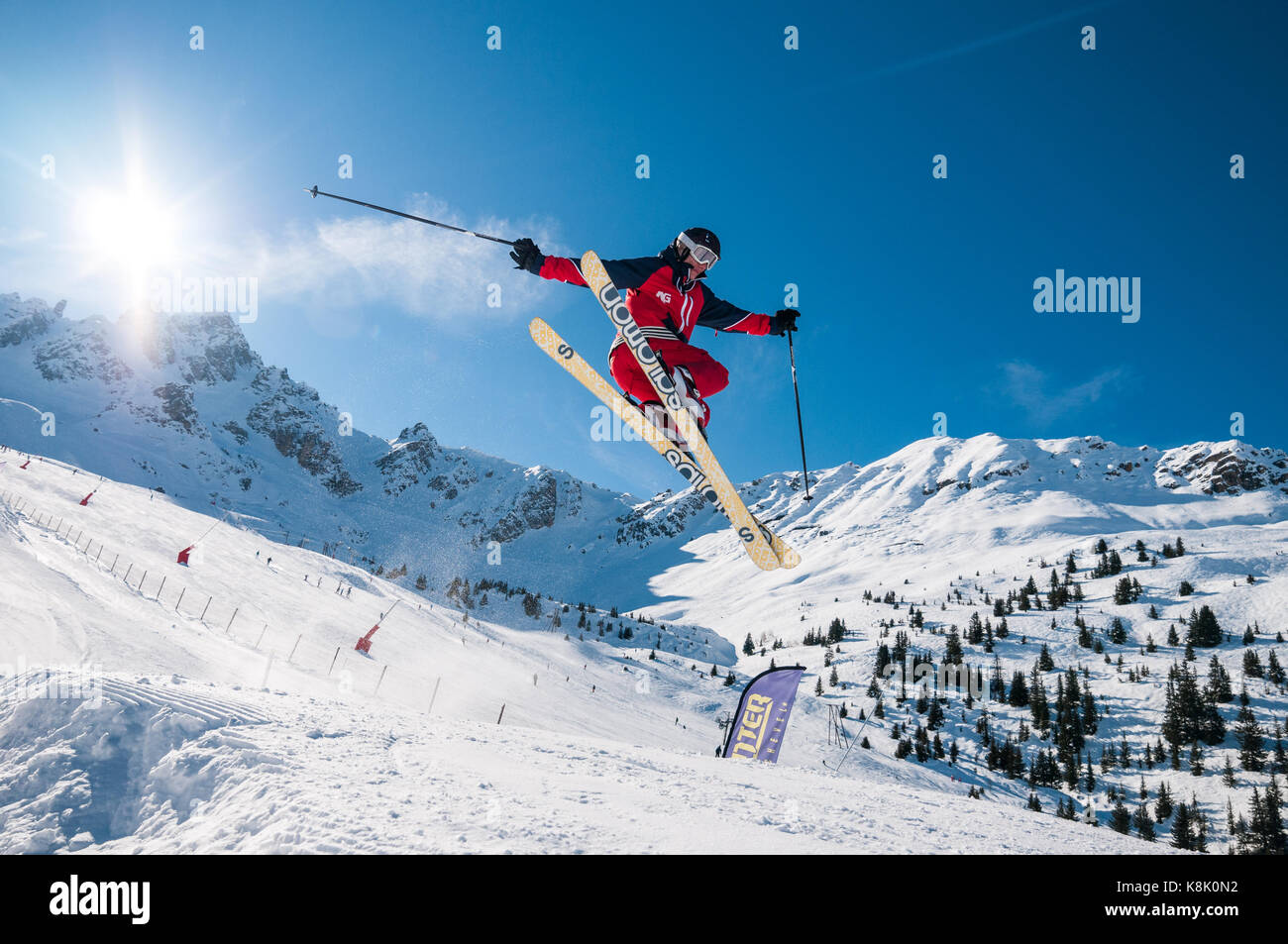 skier-jumping-off-snow-ramp-in-to-the-ai