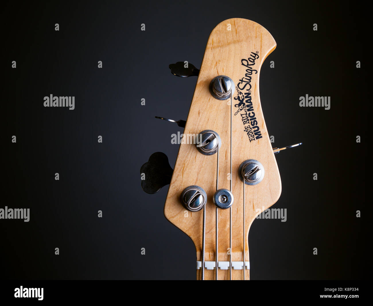 the headstock of a 4 string musicman stingray bass guitar