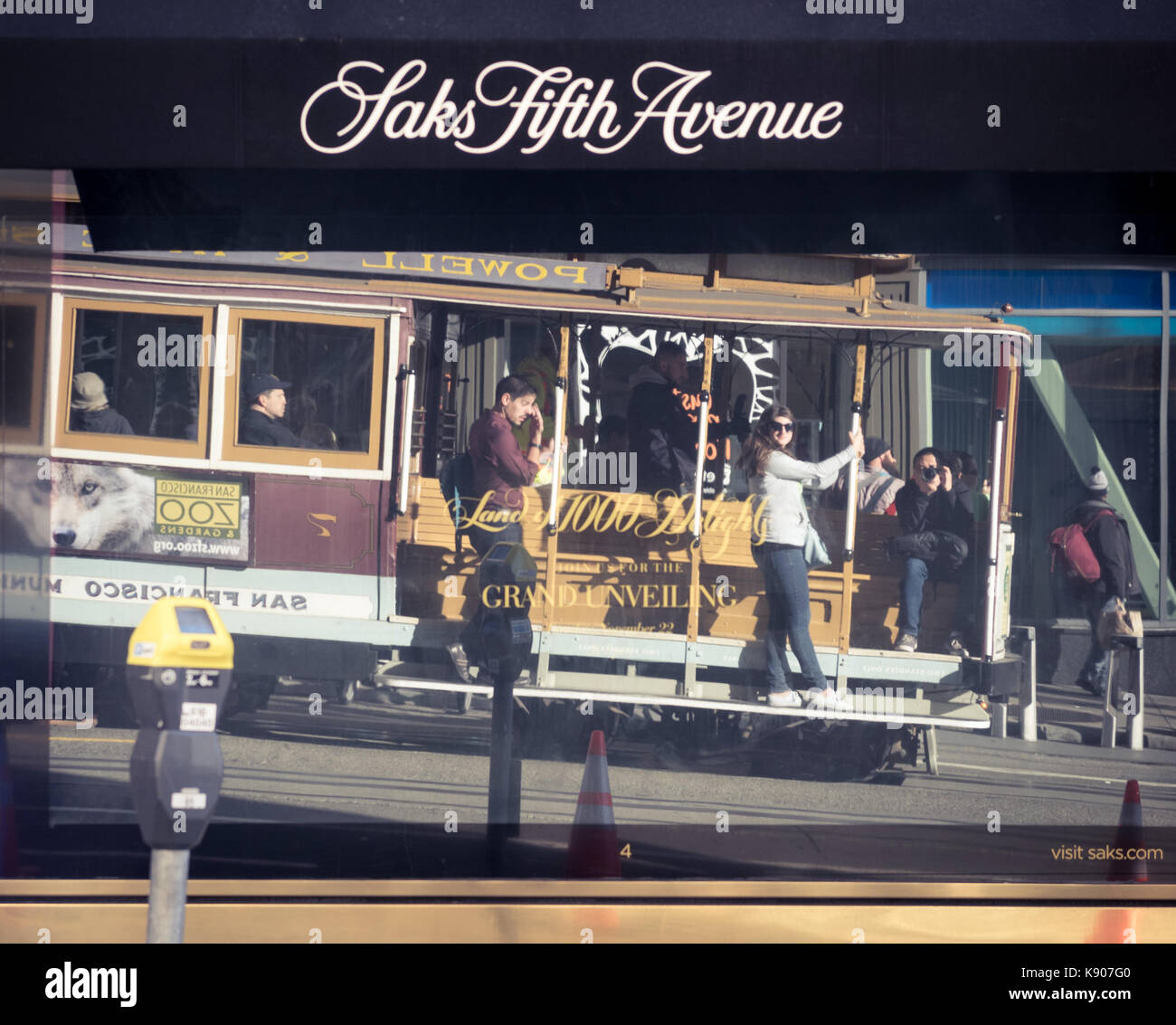 A reflection of a Hyde-Powell street car from the window of the Saks Fifth Avenue store at Union Square in San Francisco. - Stock Image