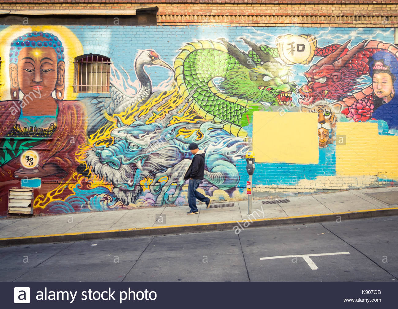 An untitled mural by artist Francisco Aquino on Commercial Street in Chinatown in San Francisco, California, USA. - Stock Image