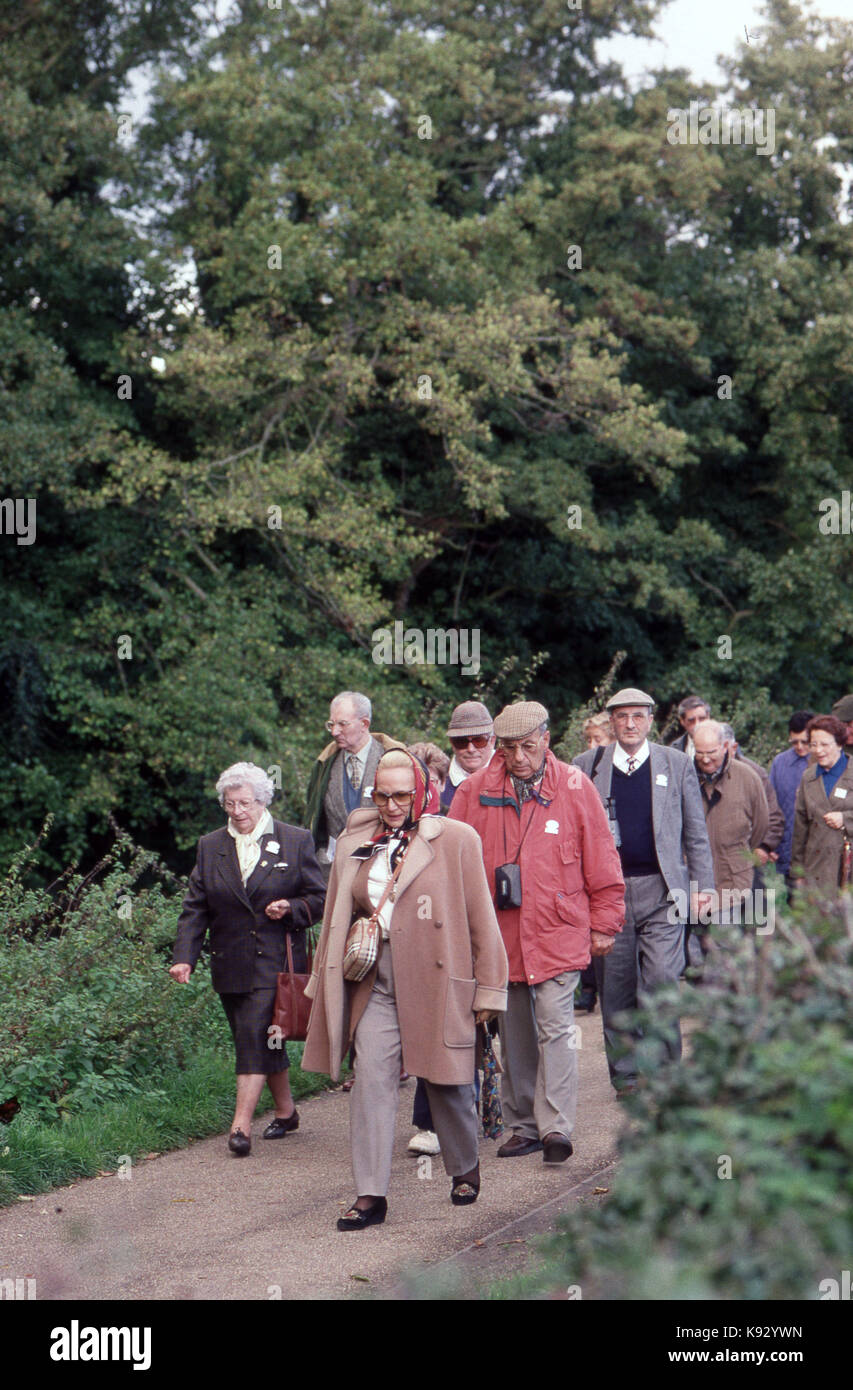 Elderly people on a walking tour in the countryside - Stock Image