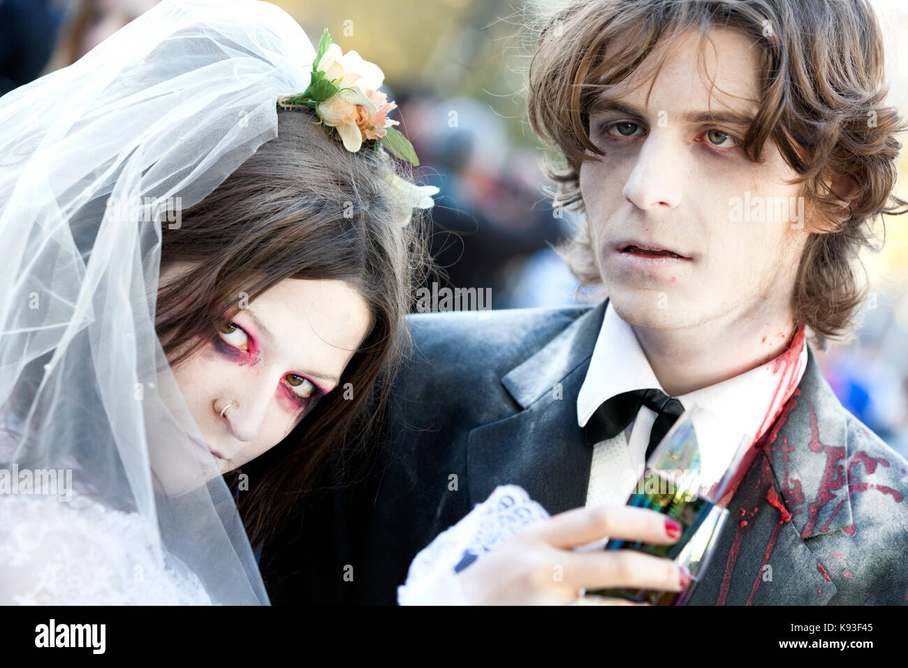 Two people, male and female, dressed as a zombie bride and groom at a zombie wedding - Stock Image