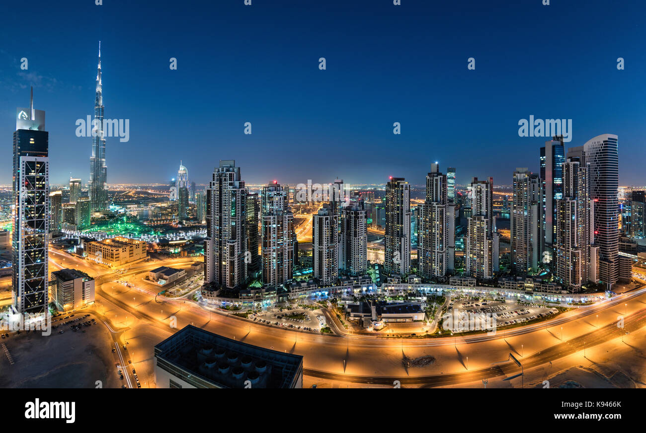 Cityscape of Dubai, United Arab Emirates. at dusk, with illuminated skyscrapers in the foreground. - Stock Image