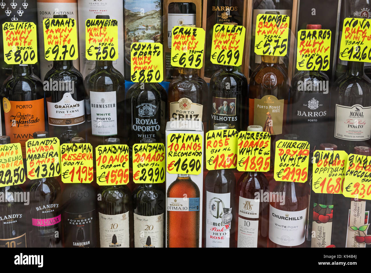 Bottles of port in shop window. Porto Portugal - Stock Image