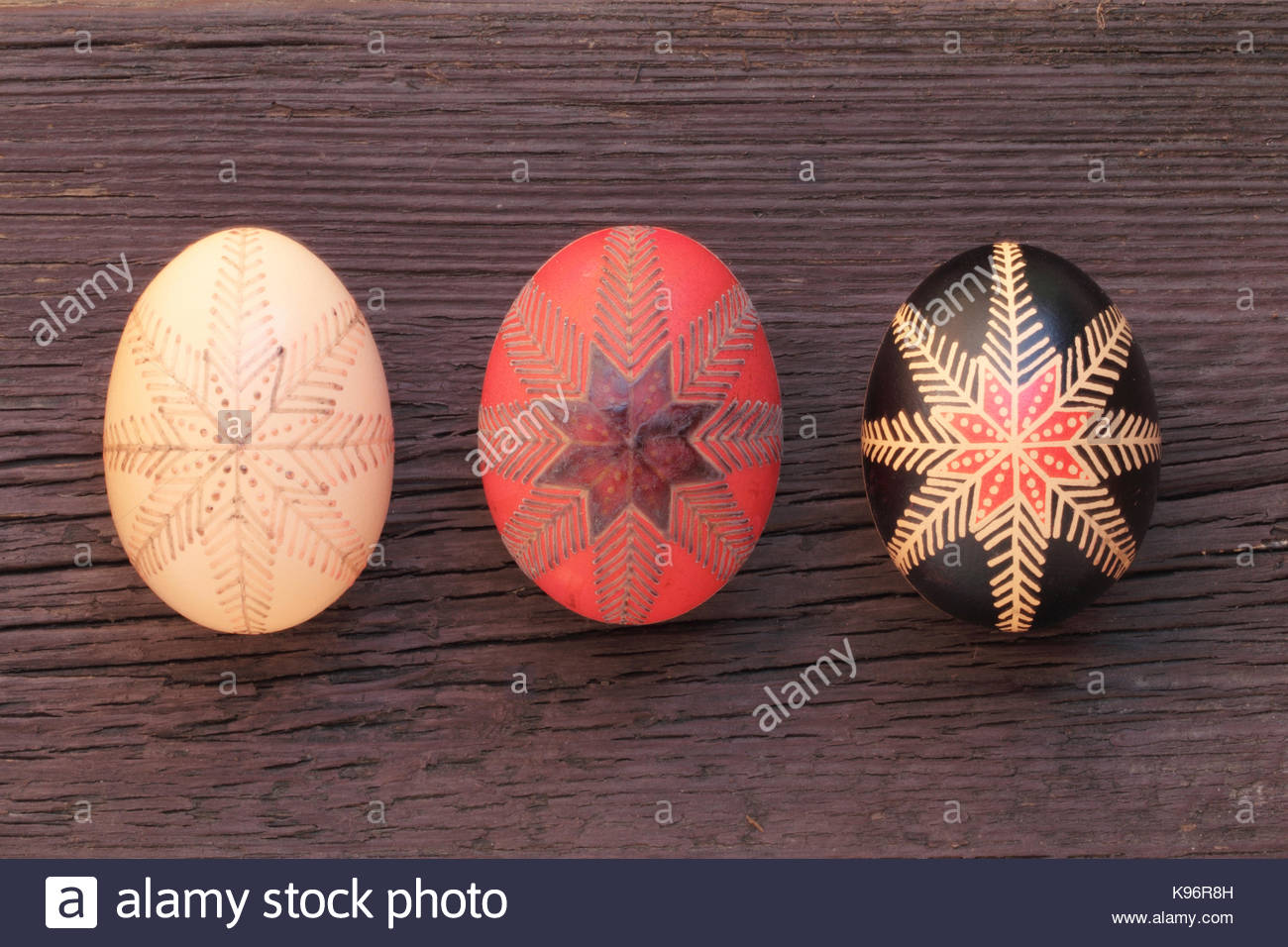 Phases of wax-resist painting method on chicken egg with traditional Hungarian folk design. - Stock Image