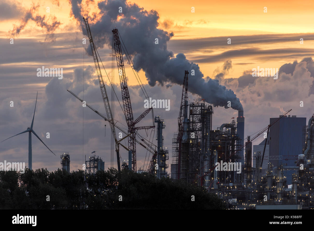 Dusk over an industrial skyline - Rotterdam - Netherlands - Stock Image