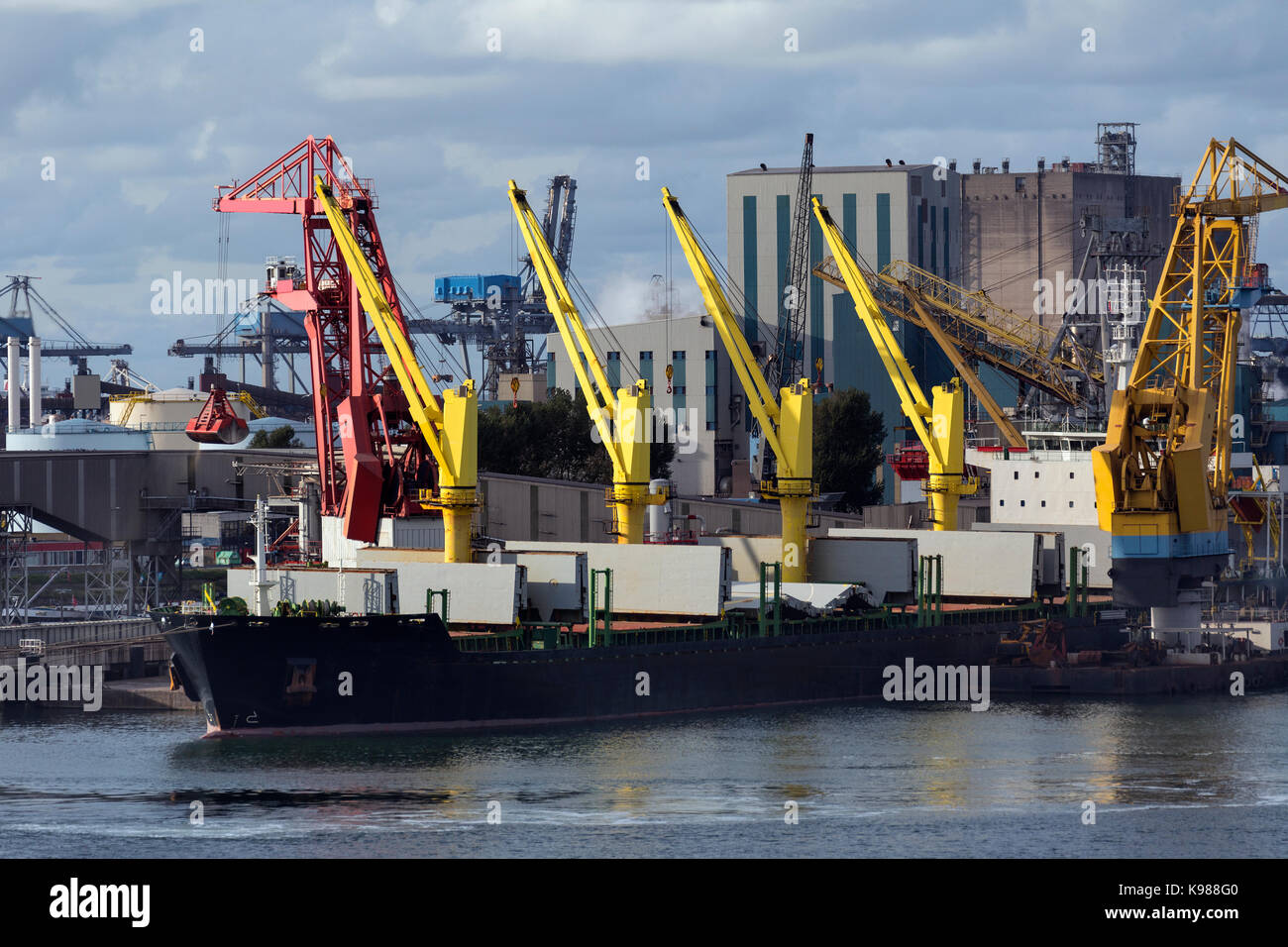 A ship being unloaded in the Port of Rotterdam in the Netherlands. - Stock Image