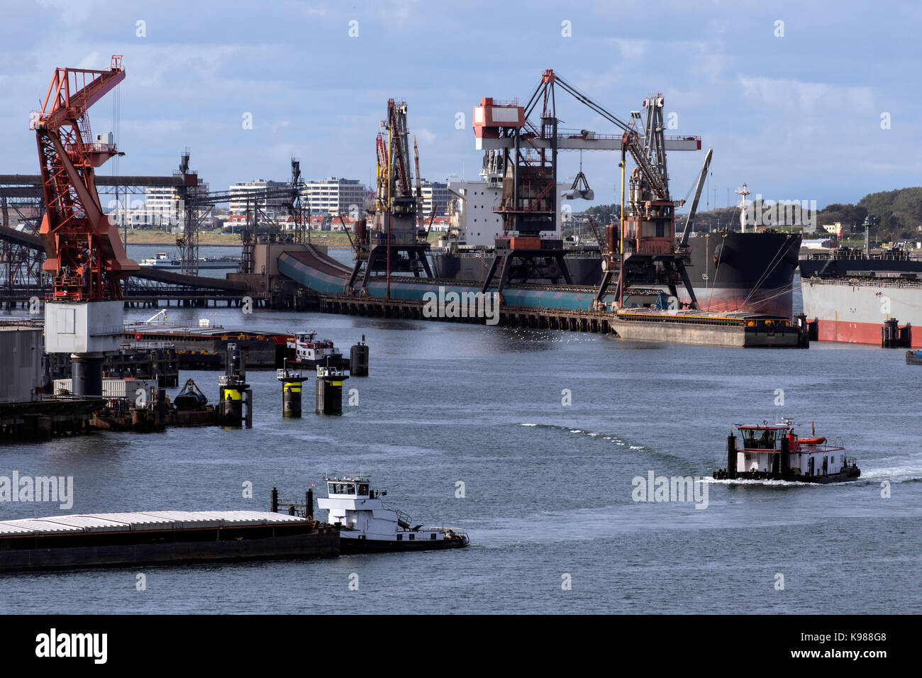 Ships being unloaded in the Port of Rotterdam in the Netherlands. - Stock Image
