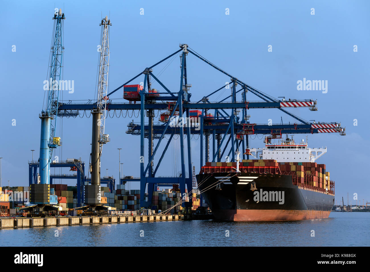 A large container ship unloading in the port of Klaipeda in Lithuania. - Stock Image
